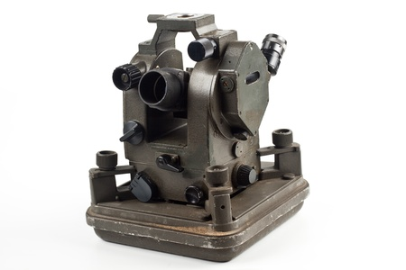 old dusty theodolite isolated on white background photo