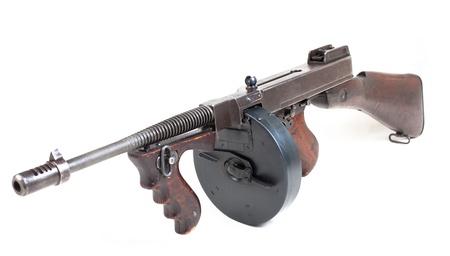 old  submashine gun isolated on white background photo