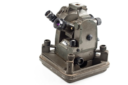 old small theodolite side view isolated on white background photo