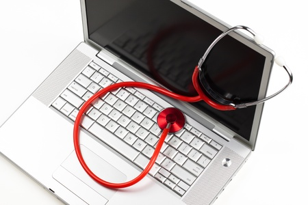 nurse computer: silver laptop diagnosis with red stethoscope crop isolated on white background Stock Photo