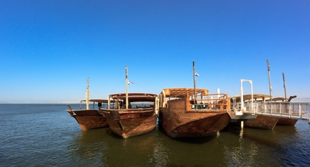 old wood boats on the galileean sea with blue sky
