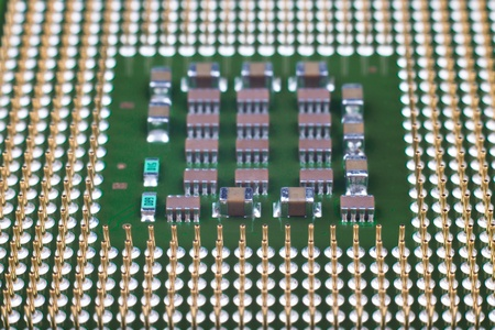 Microprocessor gold pins close-up with smd components Stock Photo - 13418752
