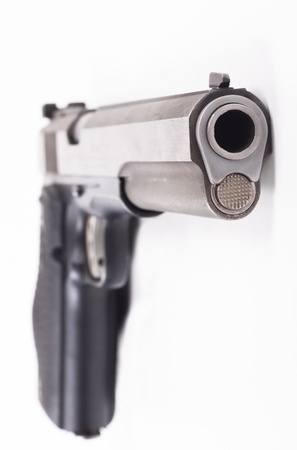 Silver color pistol closeup isolated on white background Stock Photo - 14021791