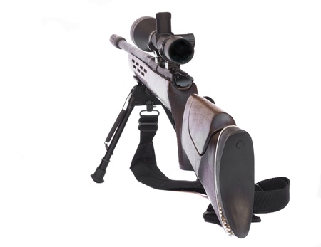 Sniper Rifle with scope atached on a tripod rear view isolated on white background photo