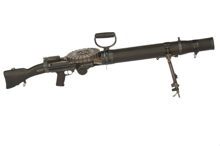 Old WW2 heavy machinegun side view isolated on white photo