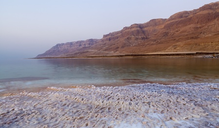 Dead sea lanscape with salt structures on the shore and desert mountains in the background Stock Photo - 15075967