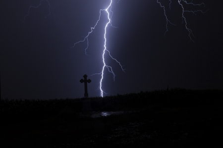 Lightning in a storm with a cross and reflection of the lightning Stock Photo - 15075971