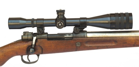 Rifle scope close-up side view isolated on white background photo