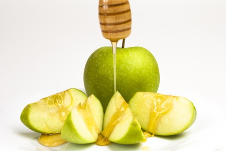 rosh: Green apple and honey isolated on white background
