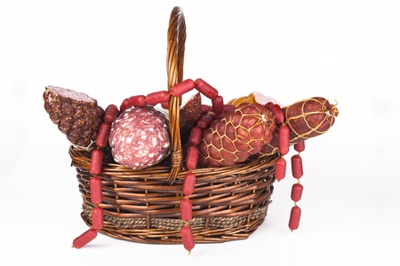 white sausage: Various salami products in a basket isolated on white background Stock Photo