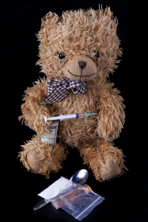 junky: TeadyBear the Junky narcotic addict with syringe in the hand Stock Photo