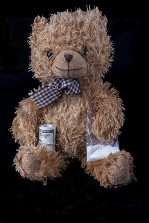 TeadyBear the notorious drug dealer on black background photo