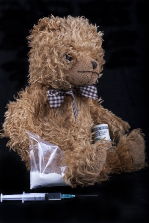 TeadyBear the notorious drug dealer syrunge in the foreground and black background Stock Photo - 15652200