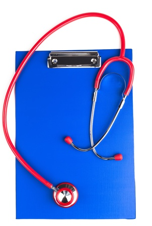 Red stethoscope on a empty  blue clipboard isolated on white background photo