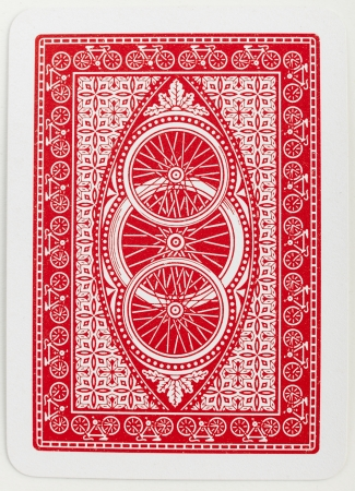 back light: Playing card back red abstract floral pattern closeup