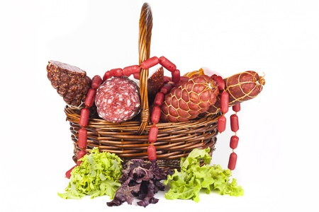 Basket full with salami and green salad aside photo