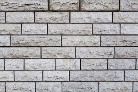 Aged brown Rectangular stone wall texture closeup photo