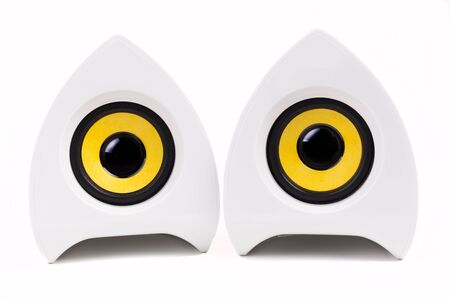 Pair of  White speakers with black and yellow isolated on white background photo