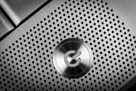 poweron: silver color  power button macro closeup  with holes grid arround Stock Photo