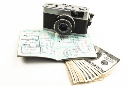 Open Israeli  passport full page visa with an old camera and dollars isolated on white background photo