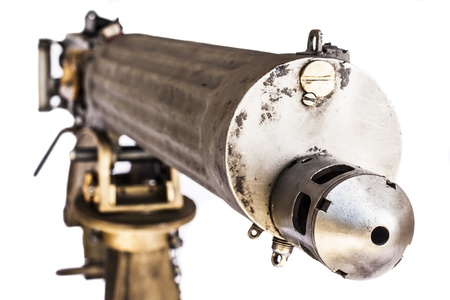 old Silver and gold color machine gun front closeup isolated on white background Stock Photo - 18247365
