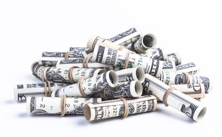Pile of rolled dollars with elastic band isolaten on white background photo