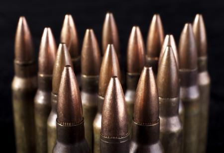 arsenal: Bullets closeup on black backgrounds
