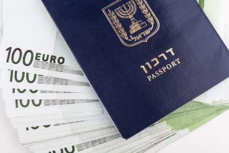 Israeli passport closeup with euro banknotes in the middle photo