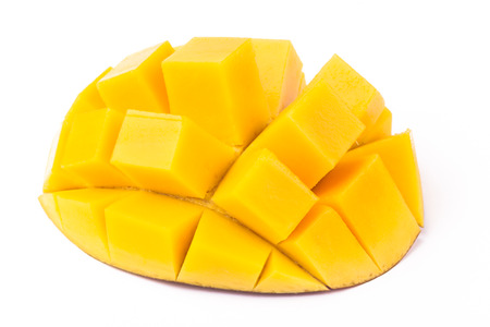 Mango slice cut to cubes close-up isolated on white background photo