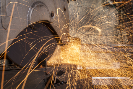 Metal cutting close-up with electrical grinder with sparks  photo