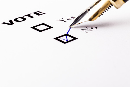 Voting yes or no checkbox with fountain pen no marked with V photo
