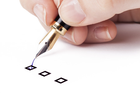 put tick: Female hand holding fountain pen and Marking  in top check-box