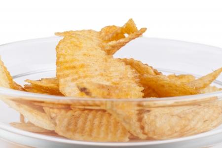 Potato chips ina bowl closeup isolated on white background photo