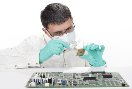 Man repairing microchip electronic equipment with mangifying glass isolated on white background Stock Photo