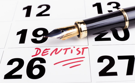 Dentist appointment marked n calendar with  fountain pen Stock Photo
