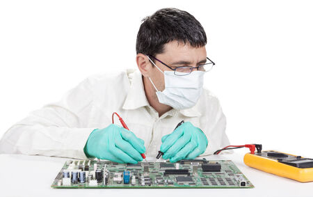 Man measuring on elecrtronic circuit board with 2 probes isolated on white photo