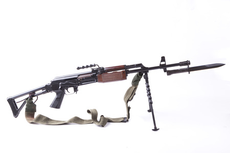 old machine gun with tripod and bayonet isolated on white photo
