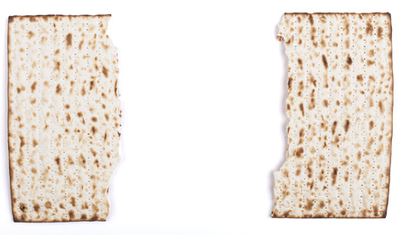 matzo: Broken in half Jewish traditional Pesach textured Matza bread substitute isolated on white background Stock Photo