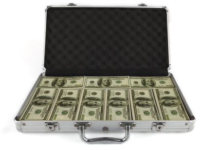 briefcase full with dollar banknotes isolated on white background photo