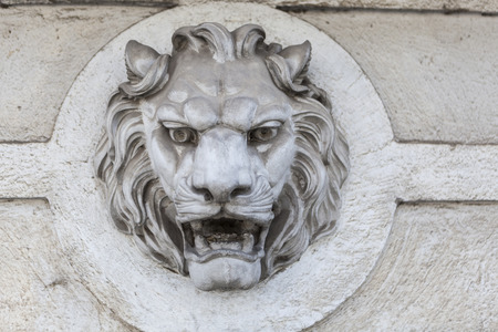 heads old building facade: Lion head building exterior wall sculture decoration Stock Photo