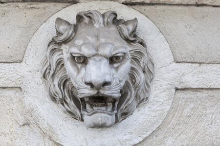 face guard: Lion head building exterior wall sculture decoration Stock Photo