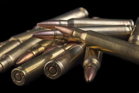 Rifle bullets close-up on black background photo