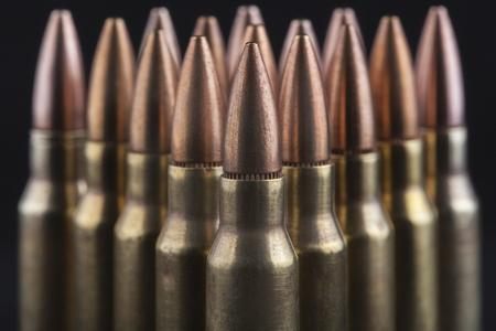 m16 ammo: Rifle bullets close-up on black background Stock Photo