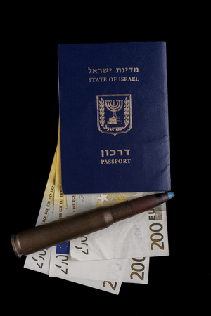 Israelian passport with 200 euro banknotes and a big rifle bullet isolated on black photo