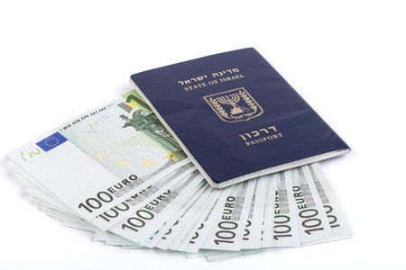 Israeli passport with 100 euro banknotes isolated on white background photo