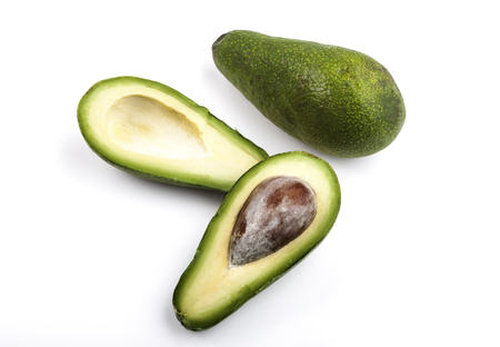 two and a half: Two avocado one cut in half isolated on white background Stock Photo