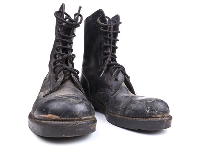 army boots: Black Dirty army boots isolated on white background