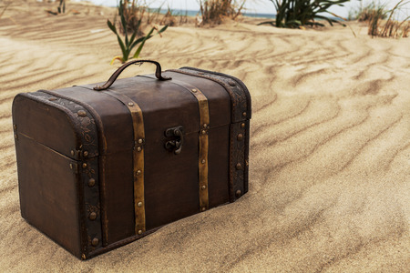 treasure: Treasure chest in sand dunes on the beach
