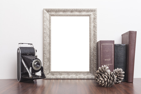 scrapbook frame: Silver Frame with old books and old camera on wood table