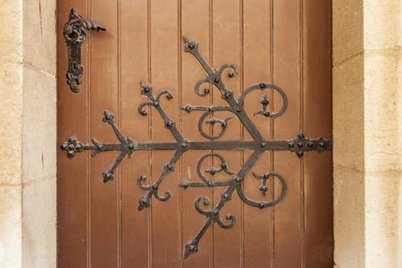 verdigris: Old floral church door black hinge